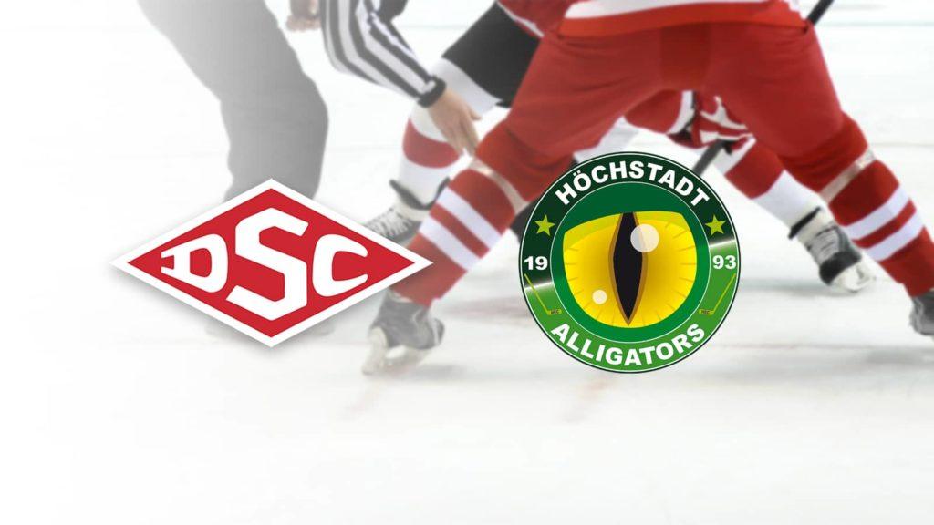 Logos Deggendorfer SC und Höchstadt Alligators. Im Hintergrund: Eishockeyspieler beim Bully